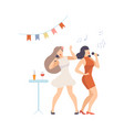 two cheerful women sing into microphones on party vector image