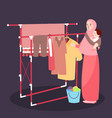 mom hanging clothes on the line wearing veil while vector image vector image
