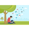 Young man sitting in the park under a tree and vector image vector image