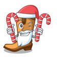 santa with candy leather cowboy boots shape vector image vector image