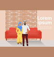 arab couple sitting on couch in modern loft living vector image