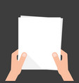 two hands holding white sheet vector image