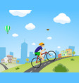 man rides a bicycle down the street vector image