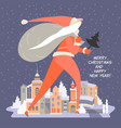 winter cityscape with a huge santa claus vector image