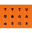Medals and cup icons on orange background vector image