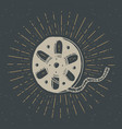 cinema tape and film reel vintage label hand vector image