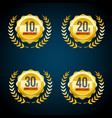 10 to 40 years anniversary gold and red badge logo vector image
