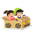 boy and girl driving with cardboard car vector image