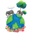 Two elephants walking at the earths surface vector image