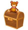A bear at the top of a treasure chest vector image vector image