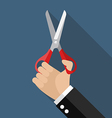 Hand holding a pair of scissors vector image