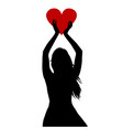 woman silhouette holding a big red heart in her vector image vector image
