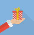 Santa hand holding christmas gift box vector image vector image