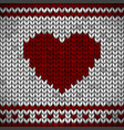 white knitted fabric with a red ornament and heart vector image vector image