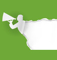 man with megaphone ripping green paper vector image vector image