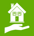 hand holding house icon green vector image vector image