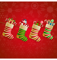Hanging christmas socks with present vector image vector image