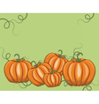 Fresh Pumpkins on green vector image vector image