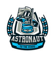 emblem logo an astronaut salutes and holds a vector image vector image