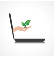 hand holding plant comes from laptop screen vector image vector image