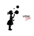 little child baby little girl blows soap bubbles vector image