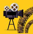 short film video camera with reel filmstrip vector image vector image