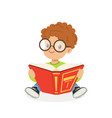 cute redhead boy wearing glasses reading a book vector image vector image