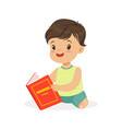 little boy sitting on the floor and reading a book vector image vector image