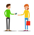 young man hands over credit card to girl who is vector image vector image