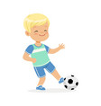 boy playing soccer kid kicking a ball colorful vector image