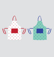two kitchen aprons with polka dot patterns vector image vector image