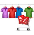 Shirts hanging on a bar and a shopping cart vector image