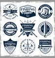fishing set of nine vintage emblems vector image