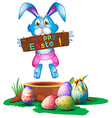 A rabbit holding an easter greeting vector | Price: 1 Credit (USD $1)