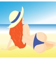 a girl lying on the beach in shorts and hat vector image vector image