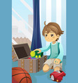 boy cleaning up his toys vector image
