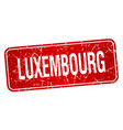 Luxembourg red stamp isolated on white background