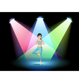 A girl doing yoga in the middle of the stage vector image vector image