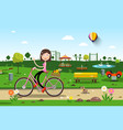 woman on bicycle in city prak with playground on vector image vector image