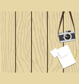 retro camera and paper on wooden background vector image vector image