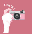 cute vintage style pink photo camera held by a vector image