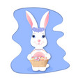 cute bunny holding wicker basket with easter eggs vector image vector image