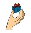 Human hand holding gift box vector image