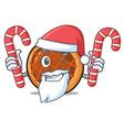 santa with candy baket pie mascot cartoon vector image vector image
