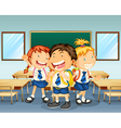 Three children smiling inside the classroom vector image vector image