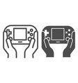 gamepad in hands line and glyph icon joypad in vector image vector image