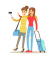 two smiling tourists girl with suitcases standing vector image vector image