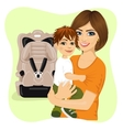 young mother holding little boy near baby car seat vector image vector image