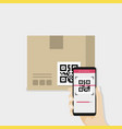 Hand holding smartphone to scan qr code on box