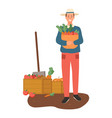farming male with basket carrots vegetables vector image vector image